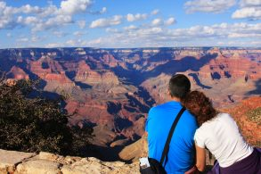 Young Couple Relaxing and Watching in to the Grand Canyon Arizona USA