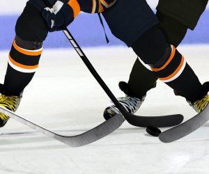 bigstock-hockey-players-on-rink-87435458