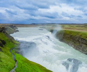 """Gullfoss, """"Golden Falls"""" in Icelandic, is one of the most popular tourist attractions in Iceland. The Hvítá River flows down into a wide curved three-step """"staircase"""" and then abruptly plunges in two stages (11 m and 21 m) into a 32 meter deep crevice. (Info from Wikipedia).  For more photos and infomration, go to the Gullfoss web site, http://www.gullfoss.is"""